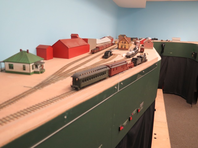 The layout's scenery is about 50% complete.  Dale make use of mockups to see how the scenes will look.