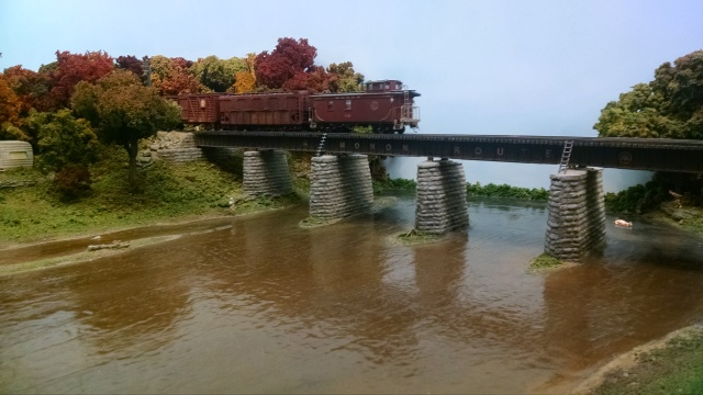 Railfanning our caboose as it crosses a bridge