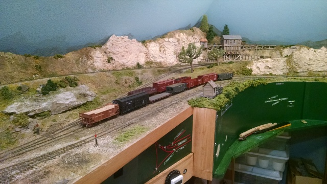 The switchback branch goes up to the mining district. Cars are exchanged in this yard.
